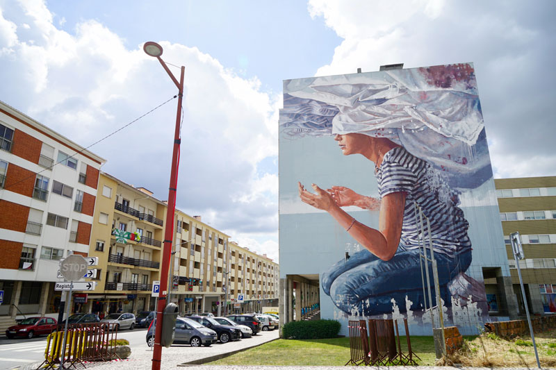 """Head in the clouds"" Street Art Fintan Magee Estarreja"